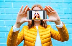 Free Closeup Woman Takes Picture Self Portrait On Smartphone On Blue Royalty Free Stock Photography - 105373967