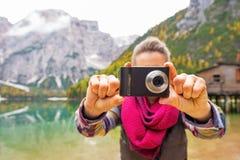 Closeup on woman taking photo on lake braies Stock Image