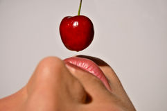 Closeup Of A Woman Tasting A Cherry Royalty Free Stock Photo