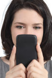 Closeup of a woman texting on a smart phone Stock Image