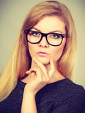 Closeup of woman thinking face expression Royalty Free Stock Photo