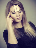 Closeup of woman thinking face expression Royalty Free Stock Image