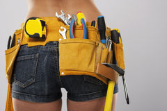 Closeup of woman with tools Royalty Free Stock Photography