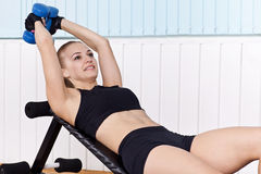 Closeup woman training with dumbbells Royalty Free Stock Photo