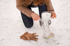 Closeup on woman tying shoelaces without gloves outdoors Royalty Free Stock Images