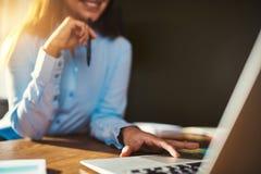 Closeup woman using laptop Stock Photos