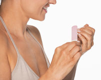 Closeup on woman using nail file Royalty Free Stock Images