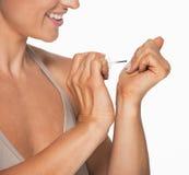 Closeup on woman using nail polish Stock Photo