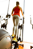 Closeup of a woman using a stepper and training in a gym Stock Images
