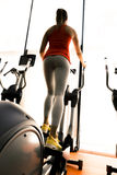 Closeup of a woman using a stepper and training in a gym Royalty Free Stock Images