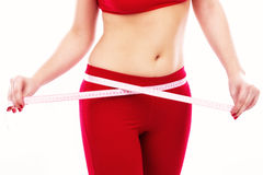 Closeup of woman waist with measuring tape healthy lifestyles co Stock Photo
