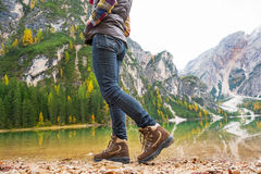 Closeup on woman walking on lake braies in italy Stock Images