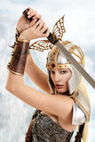 Closeup woman warrior with sword. And mountains in background royalty free stock photos