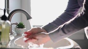 Woman washing hands in sink