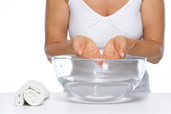 Closeup on woman washing hands in glass bowl with water Stock Image