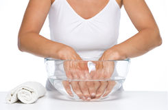 Closeup on woman washing hands in glass bowl with water Stock Images