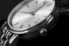 Closeup of woman watch on a black background Royalty Free Stock Photography