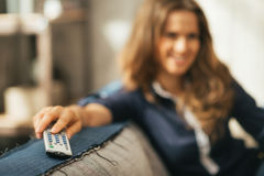 Closeup on woman watching tv in loft apartment Royalty Free Stock Images
