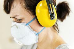 Closeup of Woman wearing ear protection stock photos