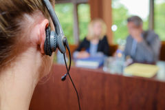 Closeup woman wearing headset in conference room Royalty Free Stock Photo