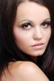 Closeup woman wearing pink and green eye shadow Stock Photography