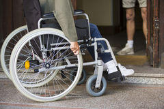 Closeup of woman in wheelchair at an entrance Stock Photo