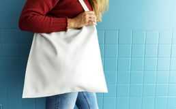 Closeup of woman with white tote bag stock image