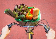 Closeup of woman winth groceries in a basket bike royalty free stock images