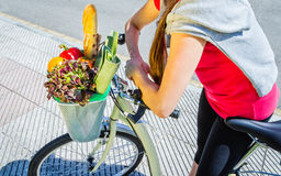 Closeup of woman winth groceries in a basket bike Royalty Free Stock Image