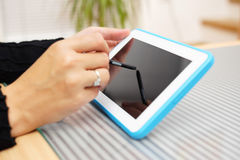 Closeup of woman working with pen on tablet pc.  Stock Images