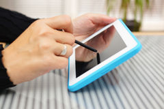 Closeup of woman working with pen on tablet pc.  Royalty Free Stock Photos