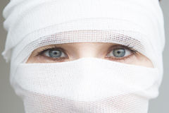 Closeup of woman wrapped in bandages Royalty Free Stock Photo