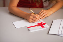 Closeup on woman writing on christmas letter in kitchen Stock Photo