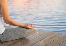 Closeup woman yoga finger acting on hands. In soft focus background with nature surrounding. Concept of healthy lifestyle and relaxation stock image