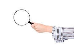 Closeup of womans arm holding a magnifying glass Stock Image