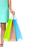 Closeup of womans hand with shopping bags. Stock Images