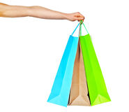 Closeup of womans hand with shopping bags. Stock Photos