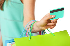 Closeup of womans hand with shopping bags and credit card. Stock Photo