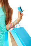 Closeup of womans hand with shopping bags and credit card. Royalty Free Stock Photos