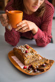 Closeup of womans hands holding mug with home-made baking Stock Image