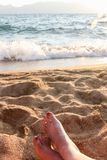 Closeup of Womans Legs and Feet at the Beach Royalty Free Stock Image