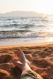 Closeup of Womans Legs and Feet at the Beach Stock Photo