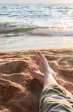Closeup of Womans Legs and Feet at the Beach Royalty Free Stock Photos