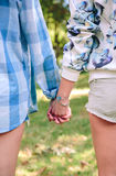Closeup of women holding hands over nature Royalty Free Stock Images