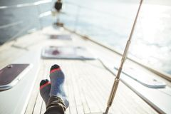 Closeup on women`s feet in socks on the yacht, lifestyle, pleasure concept. Carefree vacation Stock Photography