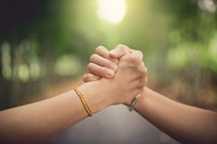 Closeup women`s handshaking royalty free stock photography