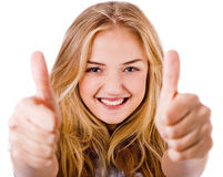 Closeup of women showing thumbs up in both hands Royalty Free Stock Images