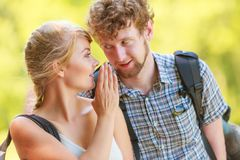 Woman telling her boyfriend some secrets Royalty Free Stock Photo