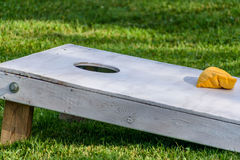 Closeup of a wood bags game board. Corn hole game outside in backyard on sunny day in summer stock photo