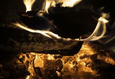 Closeup of wood burning and embers in fireplace or campfire Stock Photo